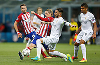 Calcio, finale di Champions League: Real Madrid vs Atletico Madrid. Stadio San Siro, Milano, 28 maggio 2016.<br /> Atletico Madrid Fernando Torres, left, and Real Madrid's Sergio Ramos fight for the ball during the the Champions League final match between Real Madrid and Atletico Madrid, at Milan's San Siro stadium, 28 May 2016. At right, Real Madrid's Casemiro.<br /> UPDATE IMAGES PRESS/Isabella Bonotto
