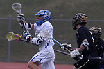 Dan Tempone (left) of Holmdel High School gets free from Southern Regional defenders as Holmdel takes on Southern Regional in a boys varsity lacrosse game held at Roggy Field at Holmdel High School in Holmdel on Thursday March 29, 2018.<br />  Mark R. Sullivan | For NJ Advance Media