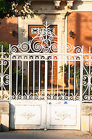 A suburban villa in Cournonsec with wrought iron fence. Montpellier. Languedoc. The gate. France. Europe.