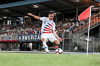 GEORGETOWN, GRAND CAYMAN, CAYMAN ISLANDS - NOVEMBER 19: Daniel Lovitz #5 of the United States takes a corner kick during a game between Cuba and USMNT at Truman Bodden Sports Complex on November 19, 2019 in Georgetown, Grand Cayman.