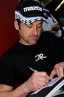 Patrick Dempsey, #40 Dempsey Racing RX-8, at work during the autograph session
