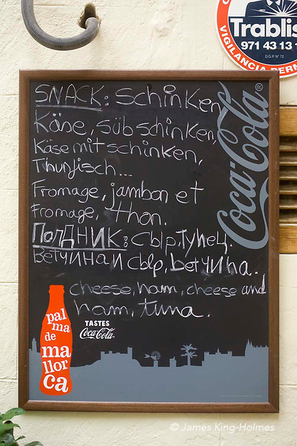 Multi-lingual menu outside a cafe in central Palma de Mallorca. The available food is listed in German, French, Russian and English.