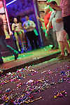 "After Madden Gras, colored ribbons line the ground of Bourbon Street in New Orleans's French Quarter.  An adult nightclub is advertised in the background.  EA Sports, creator of the popular ""Madden NFL"" game, celebrates the release of the 2011 game edition with Madden Gras 2011, starring the New Orleans Saints.  Madden Gras 2011 culminates with a Mardi-Gras-style parade through the French Quarter of New Orleans to Jackson Square."
