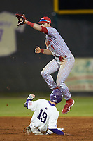 St. John's Red Storm shortstop Jake Lazzaro (7) leaps for a high throw as Daniel Walsh (19) of the Western Carolina Catamounts steals second base at Childress Field on March 13, 2021 in Cullowhee, North Carolina. (Brian Westerholt/Four Seam Images)