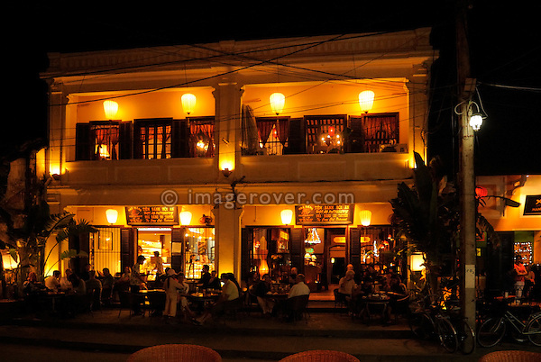 Asia, Vietnam, Hoi An. Hoi An old quarter. Romantic night time at Cafe Patisserie Tiem Banh. The historic buildings, attractive tube houses, and decorated community halls have 1999 earned Hoi An's old quarter the status of a UNESCO World Heritage Site. To protect the old quarter's character stringent conversation laws prohibit alterations to buildings, as well as the presence of cars on the roads.