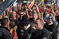 """Neonazis und Hooligans demonstrieren gegen Angela Merkel.<br /> Unter dem Motto """"Merkel muss weg"""" zogen ca. 1.200 am Samstag den 30. Juli 2016 mit einer Demonstration durch Berlin. Der Aufmarsch war vom einschlaegig bekannten Neonazi-Hooligan Enrico Stubbe angemeldet worden.<br /> Die Polizei hatte die Aufmarschroute der Rechten weitraeumig abgesperrt.<br /> Die Rechten forderten in Sprechchoeren immer wieder """"Nationalen Sozialismus! Jetzt!"""" (ein strafrechtlicher Trick, gemeint ist der Nationalsozialismus), beschimpften waehrend ihres Aufmarsches permanent Gegendemonstranten """"Wir kriegen euch alle"""" und """"Hurensoehne"""" (im Bild) und die Medienvertreter """"Luegenpresse"""". Mitarbeiter der Sicherheitsbehoerden erklaerten, dass es eindeutig ein rechtsextremer Aufmarsch gewesen sei bei dem sich keinerlei buergerliche Teilnehmer beteiligt haetten. Der Berliner Chef des Landesamt fuer Verfassungsschutz war persoenlich vor Ort um sich einen Eindruck zu verschaffen.<br /> 30.7.2016, Berlin<br /> Copyright: Christian-Ditsch.de<br /> [Inhaltsveraendernde Manipulation des Fotos nur nach ausdruecklicher Genehmigung des Fotografen. Vereinbarungen ueber Abtretung von Persoenlichkeitsrechten/Model Release der abgebildeten Person/Personen liegen nicht vor. NO MODEL RELEASE! Nur fuer Redaktionelle Zwecke. Don't publish without copyright Christian-Ditsch.de, Veroeffentlichung nur mit Fotografennennung, sowie gegen Honorar, MwSt. und Beleg. Konto: I N G - D i B a, IBAN DE58500105175400192269, BIC INGDDEFFXXX, Kontakt: post@christian-ditsch.de<br /> Bei der Bearbeitung der Dateiinformationen darf die Urheberkennzeichnung in den EXIF- und  IPTC-Daten nicht entfernt werden, diese sind in digitalen Medien nach §95c UrhG rechtlich geschuetzt. Der Urhebervermerk wird gemaess §13 UrhG verlangt.]"""