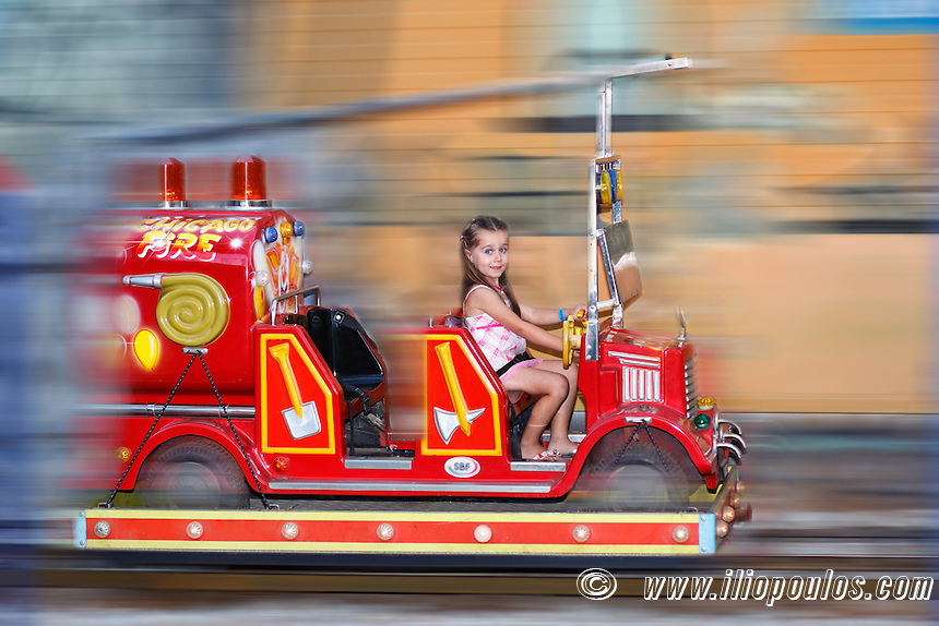 A pretty little girl having fun with fire truck