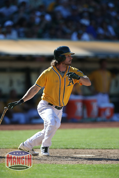 OAKLAND, CA - JUNE 13:  John Jaso #5 of the Oakland Athletics bats against the New York Yankees during the game at O.co Coliseum on Thursday June 13, 2013 in Oakland, California. Photo by Brad Mangin