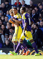 Pictured: Jonathan de Guzman of Swansea (C) with team mates Jose Canas (L) and Dwight Tiendalli (R) celebrating his equaliser making the score 1-1. Sunday 16 February 2014<br /> Re: FA Cup, Everton v Swansea City FC at Goodison Park, Liverpool, UK.
