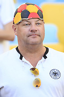 Germany fan with a football on his head