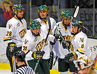 10 January 2009: Members of the University of Vermont Catamounts celebrate a third period goal against the Boston College Eagles during the second game of a weekend series at Gutterson Fieldhouse in Burlington, Vermont. The Catamounts rallied from an early 2-0 deficit to defeat the visiting Eagles 4-2. Mandatory Photo Credit: Ed Wolfstein Photo