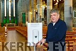 Fr Kieran O'Brien with the hand sanitiser that have been installed into St Mary's Cathedral Killarney