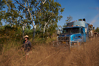 Truck driver Nick Atkins walks a track overgrown by grass, close to the  Gibb River Road, on his way from Kununurra to Kalumburu.