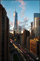 Full view of the 1 WTC at sunset with traffic light trails.