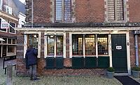 Nederland  Haarlem - 2020. De vleeshal is een historisch gebouw aan de Grote Markt in Haarlem waarin tegenwoordig het museum De Hallen is gevestigd. Aan de buitenzijde Jelek Goud. Goud- en zilverinkoop. Bij Jelek Goud kan men terecht voor verkoop of verpanding van alle edelmetalen zoals gouden en zilveren sieraden of voorwerpen en munten.   Foto : ANP/ HH / Berlinda van Dam