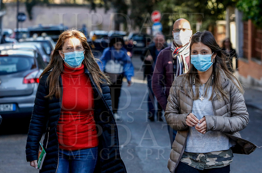 Faithful wearing masks to protect themselves from the Covid-19 arrive to attend the penitential procession on Ash Wednesday, led from the Pope to open Lent in Rome, February 26, 2020.<br />