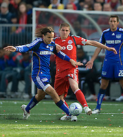 26 April 2009: Kansas City Wizards midfielder Santiago Hirsig #10 and Toronto FC midfielder Carl Robinson #33 in action at BMO Field in Toronto in a  game between Kansas City Wizards and Toronto FC..Toronto FC won 1-0.
