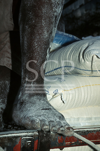 Rio de Janeiro, Brazil. Man's leg covered with flour from sacks he is delivering.