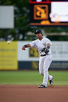 Staten Island Yankees second baseman Ezequiel Duran (25) throws to first base during a NY-Penn League game against the Aberdeen Ironbirds on August 22, 2019 at Richmond County Bank Ballpark in Staten Island, New York.  Aberdeen defeated Staten Island 4-1 in a rain shortened game.  (Mike Janes/Four Seam Images)