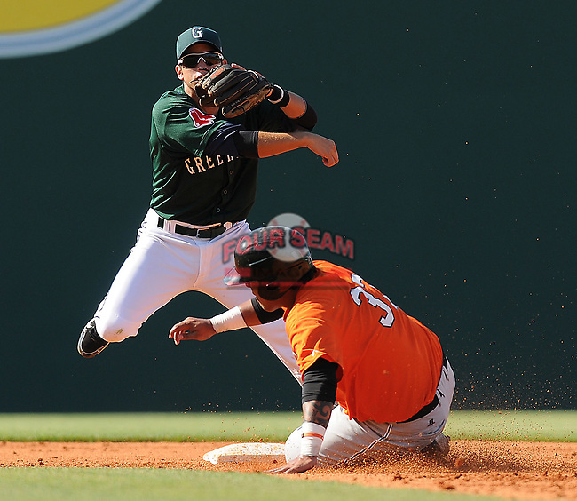 Second baseman Joantoni Garcia (36) of the Greenville Drive turns the first half of a double play, putting out Hector Sanchez (37) of the Augusta GreenJackets in a game on May 23, 2010, at Fluor Field at the West End in Greenville, S.C.
