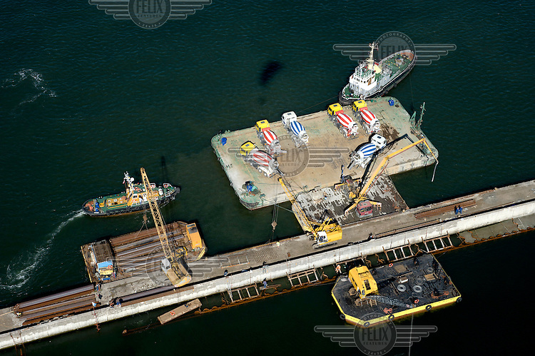 Construction of the breakwater at the Port of Gdynia.