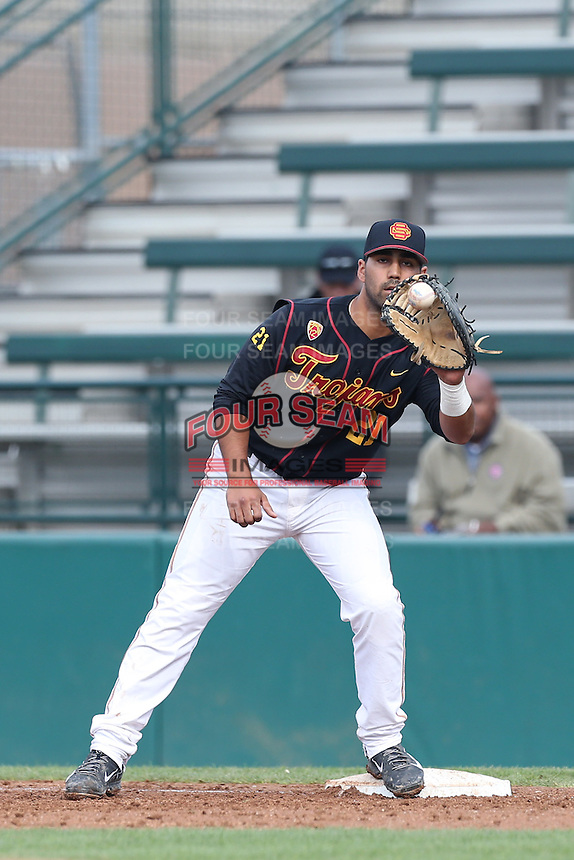 Jake Hernandez #21 of the USC Trojans catches a throw to first base during a game against the Cal Poly Mustangs at Dedeaux Field on March 2, 2014 in Los Angeles, California. Cal Poly defeated USC, 5-1. (Larry Goren/Four Seam Images)