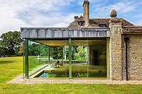 BNPS.co.uk (01202 558833)<br /> Pic: Hamptons/BNPS<br /> <br /> Pictured: The indoor swimming pool from outside.<br /> <br /> An incredible Arts and Crafts country house with its own vineyard is on the market for offers over £7m.<br /> <br /> The Grade II listed St Joseph's Hall is a striking 111-year-old property that was home to the Bishop of Arundel for 40 years.<br /> <br /> It has a wealth of period features, an indoor swimming pool and seven acres of vineyard with mostly Chardonnay grapes, which the owners sell to a local winery.<br /> <br /> The house in Storrington, West Sussex, has 17 acres of land with beautiful views over the South Downs.