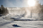 Early morning mists on a winter morning. Firehole Valley. Yellowstone National Park, Wyoming, USA. January