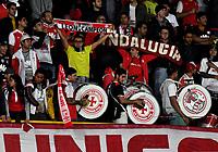 BOGOTÁ-COLOMBIA, 23–10-2019: Hinchas de Independiente Santa Fe, animan a su equipo durante partido entre Millonarios y el Independiente Santa Fe de la fecha 19 por la Liga Águila II 2019  jugado en el estadio Nemesio Camacho El Campín de la ciudad de Bogotá. / Fans of Independiente Santa Fe, cheer for their team during a match between Millonarios and Independiente Santa Fe of the 19th date for the Aguila Leguaje II 2019 played at the Nemesio Camacho El Campin Stadium in Bogota city, Photo: VizzorImage / Luis Ramírez / Staff.