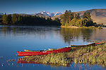 Canoes on the shore of the Flathead River in western Montana above Dixon with a Mission Mountain backdrop