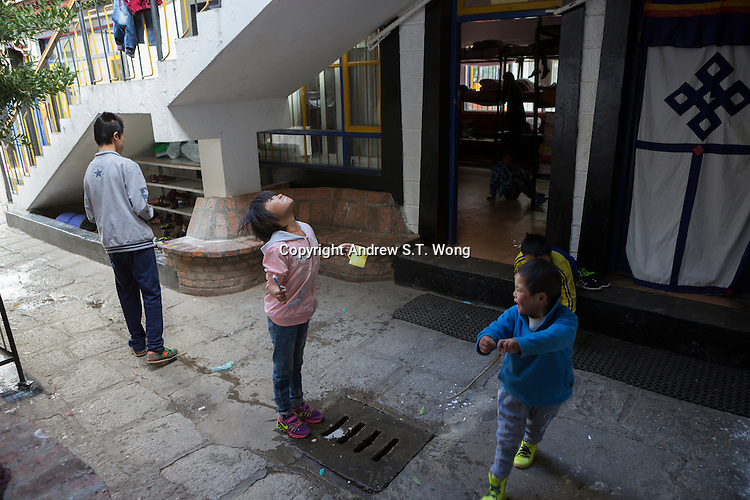 A visually impaired Tibetan girl student brushes her teeth in the morning at the School for the Blind in Tibet, in the capital city of Lhasa, September 2016.