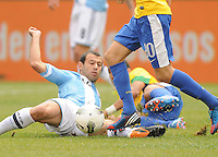 Argentina midfielder Javier Mascherano (14) goes down to make a play. The Argentina National Team defeated Brazil 4-3 at MetLife Stadium, Saturday July 9 , 2012.