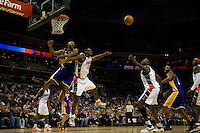 Basketball action between the Charlotte Bobcats and Los Angeles Lakers during an NBA basketball game Time Warner Cable Arena in Charlotte, NC.