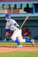 Phillip Jenkins #19 of the Burlington Royals follows through on his swing against the Kernersville Bulldogs in an exhibition game at Burlington Athletic Stadium June20, 2010, in Burlington, North Carolina.  Photo by Brian Westerholt / Four Seam Images