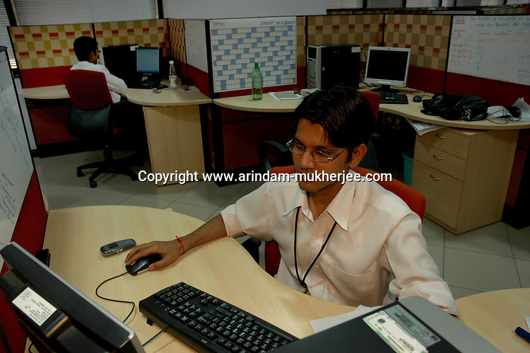 A young Indian man at work in Infosys, Bangalore. Infosys is the largest software company in the country and the head office is in Bangalore, Karnataka, India. Arindam Mukherjee