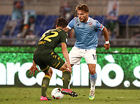Football, Serie A: S.S. Lazio - Brescia, Olympic stadium, Rome, July 29, 2020. <br /> Lazio's  Ciro Immobile (r) in action with Brescia's Andrea Papetti (l) during the Italian Serie A football match between S.S. Lazio and Brescia at Rome's Olympic stadium, Rome, on July 29, 2020. <br /> UPDATE IMAGES PRESS/Isabella Bonotto