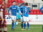 St Johnstone v Motherwell…20.02.16   SPFL   McDiarmid Park, Perth<br />Tam Scobbie gets a hug from Chris Millar at full time<br />Picture by Graeme Hart.<br />Copyright Perthshire Picture Agency<br />Tel: 01738 623350  Mobile: 07990 594431