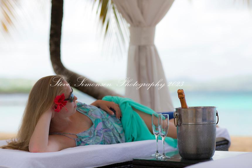 Woman relaxing under the cabana<br /> Mermaid Beach<br /> Buccaneer Hotel<br /> St. Croix<br /> U.S. Virgin Islands