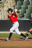 Toby Thomas (5) of the Kannapolis Intimidators follows through on his swing against the Augusta GreenJackets at CMC-NorthEast Stadium on August 3, 2014 in Kannapolis, North Carolina.  The Intimidators defeated the GreenJackets 10-5. (Brian Westerholt/Four Seam Images)