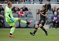 LOS ANGELES, CA - MARCH 01: GK Luis Robles #31 of Inter Miami CF meets Carlos Vela #10 of LAFC during a game between Inter Miami CF and Los Angeles FC at Banc of California Stadium on March 01, 2020 in Los Angeles, California.