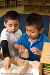 Education preschool 4 year olds block area two boys building with wooden blocks horizontal