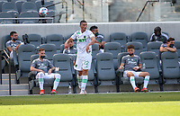 LOS ANGELES, CA - APRIL 17: Ben Sweat #22  of Austin FC  with a throw in during a game between Austin FC and Los Angeles FC at Banc of California Stadium on April 17, 2021 in Los Angeles, California.