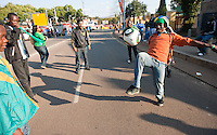 Moses Makofi of Soweto, South Africa dribbles the ball before passing to some other people outside the Loftus Versfeld Stadium before the 2010 World Cup first round match between Serbia and Ghana in Pretoria, South Africa on Saturday, June 12, 2010.