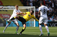 Jay Fulton of Swansea City challenges Etienne Capoue of Watford during the Premier League match between Watford and Swansea City at Vicarage Road Stadium, Watford, England, UK. Saturday 15 April 2017