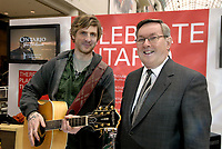 Ontario Tourism Minister Jim Bradley (right) with singer, Brian Byrne, celebrate the launch of the new domestic tourism marketing campaign at the Eaton Centre in Toronto, Wednesday, March 14, 2007. (CNW Group/Ontario Ministry of Tourism)