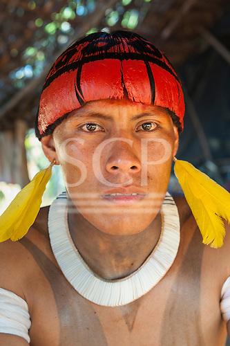 Xingu Indigenous Park, Mato Grosso, Brazil. Aldeia Matipu. Konhoho Matipu in full ceremonial red urucum decorations during the Kuarup funeral ceremony.