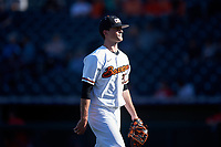 Oregon State Beavers relief pitcher Nathan Burns (24) walks off the field between innings of an NCAA game against the New Mexico Lobos at Surprise Stadium on February 14, 2020 in Surprise, Arizona. (Zachary Lucy / Four Seam Images)