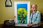 "Mary O'Neill from Lisselton after winning John Hurley's painting""Blue Sky Gorse"" in the Kerry's Eye competition."