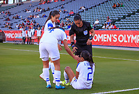 CARSON, CA - FEBRUARY 07: Melissa Borjas referee and Mariana Benavides #4 help up her teammate Gabriela Guillen #2 of Costa Rica during a game between Canada and Costa Rica at Dignity Health Sports Park on February 07, 2020 in Carson, California.