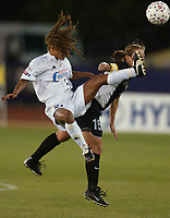Staci Wilson of the Carolina Courage battles Tiffeny Milbrett of the NY Power for the ball. The Courage defeated the Power 2-1 on Wednesday August 7th at Mitchel Athletic Complex, Uniondale, NY.